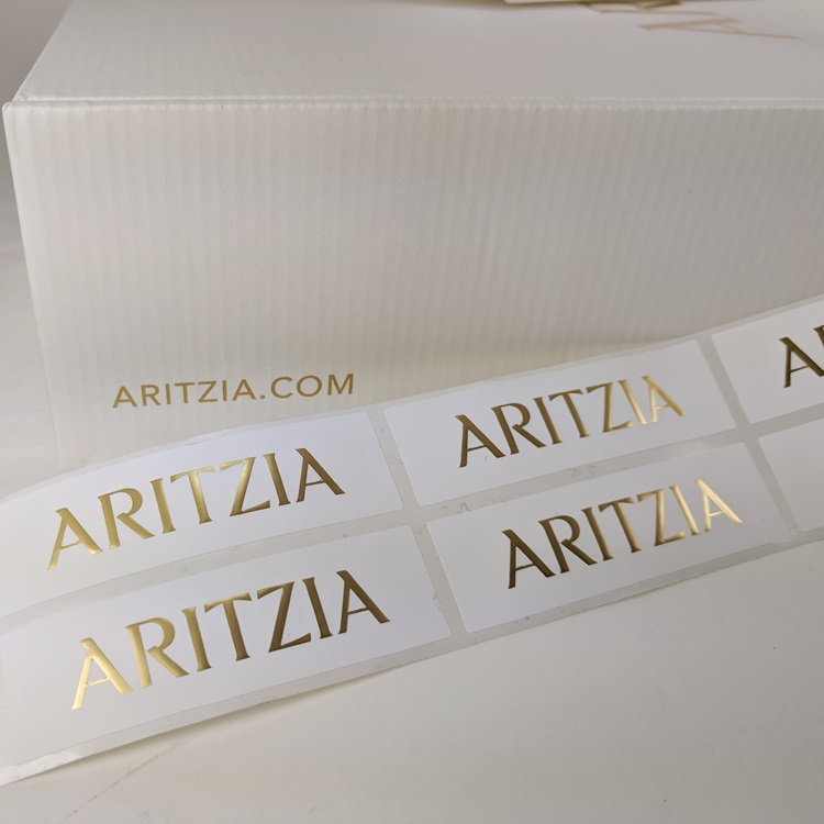 Aritzia Retail Holiday Sticker Labels with Gold Hotstamp Logo detail view