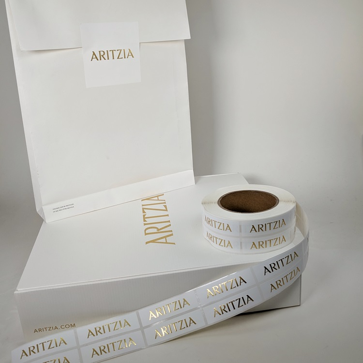 Aritzia Holiday Folding Gift Boxes with Gold Hotstamp Logo, Sticker Labels and Ecomm Paper Gusset Insert Bag reverse view