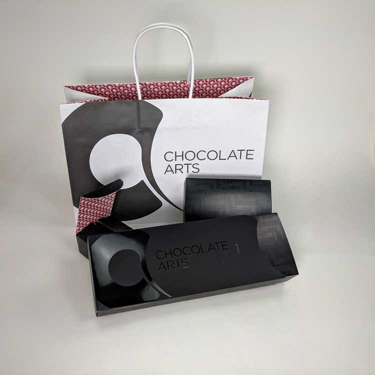 Chocolate Arts Folding Chocolate Boxes with Sleeve, UV Spot Gloss Logo and Interior Printing Detail