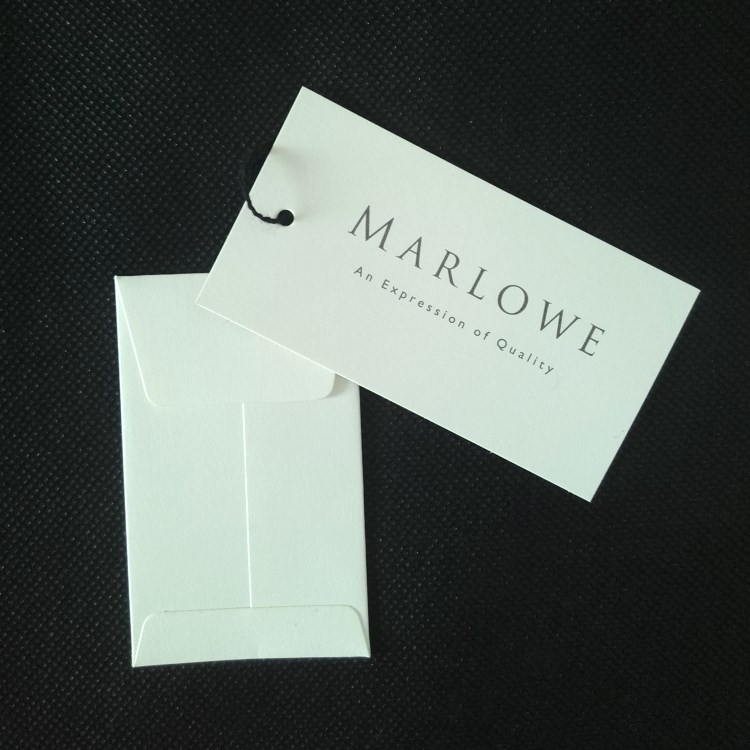 Marlowe Clothing Hangtag and Button Envelope Reverse View