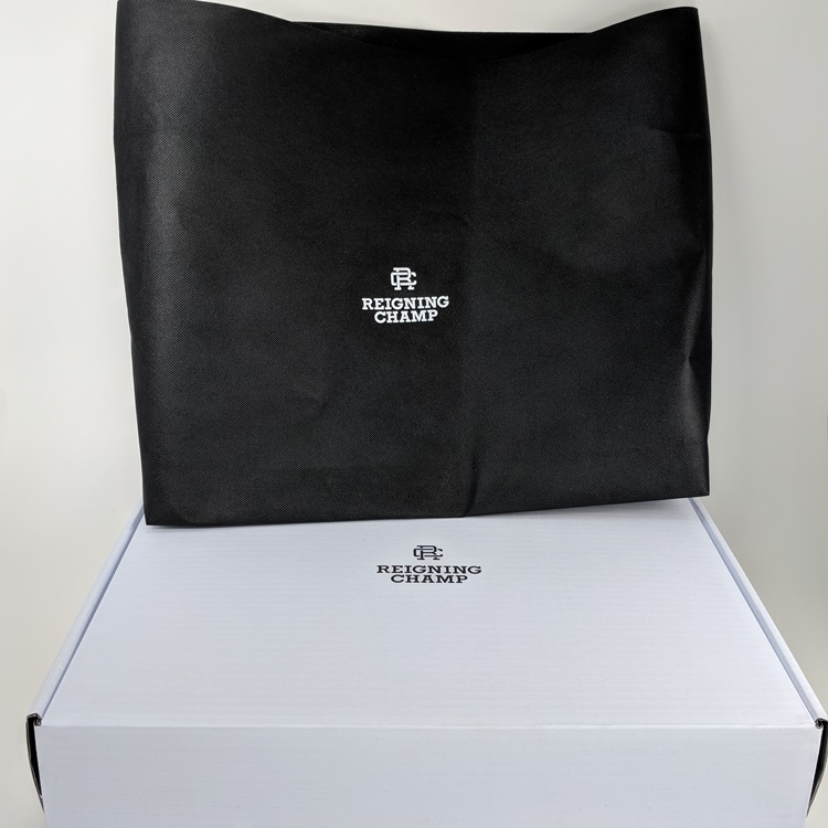 Reigning Champ EComm Folding Box and Non Woven Insert Bag Closed View
